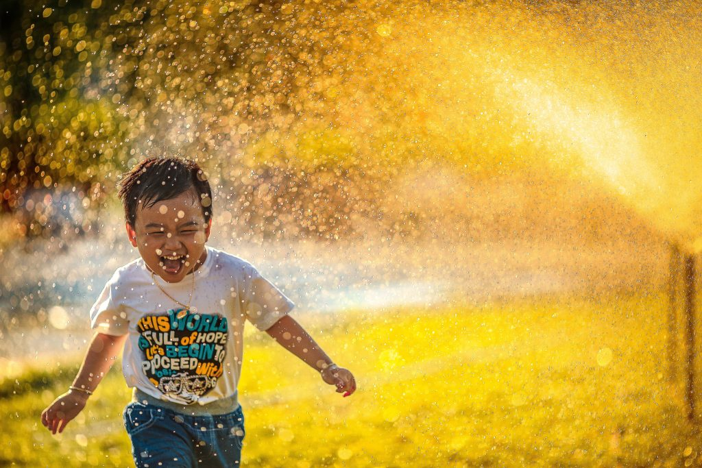 Boy plays in the sprinklers to escape the brutal Texas heat